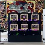 mur d'imprimantes 3D pour goodies